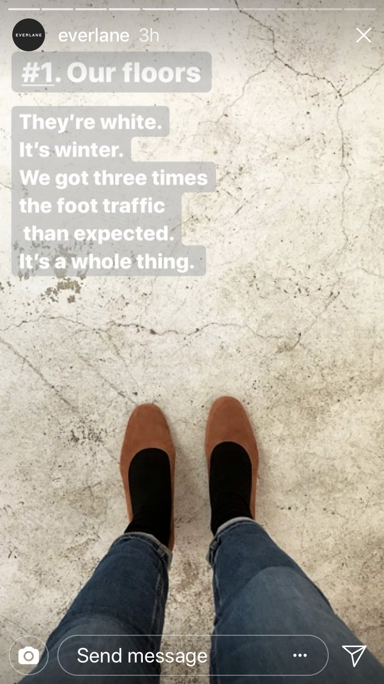 An image of a cracking, blackened floor from Everlane's New York store