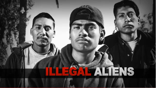 """An image from a 2010 campaign ad for Republican Sharron Angle, in which she used a stock image of Latinos with the legend """"ILLEGAL ALIENS."""""""