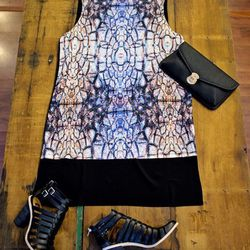"""Evil Twin dress, $83. """"This shirt-dress can be worn as a dress or as a tunic over black leather leggings. It's a little shorter in the front and the print is like a snakeskin cathedral. It's a great transition piece to wear from the end of winter into ear"""
