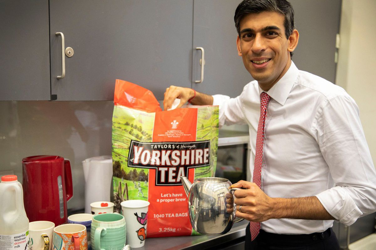 Chancellor Rish Sunak poses with a big bag of Yorkshire tea
