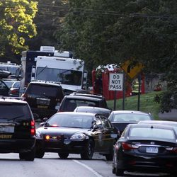 Police shut down traffic on Pontiac Trail after a suspect who shot and killed a West Bloomfield police officer and then barricaded himself in a home in West Bloomfield, Mich., Monday, Sept. 10, 2012. Gunfire could be heard during the standoff.