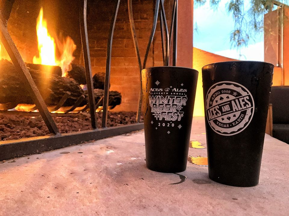 Two beers sitting beside open fireplace