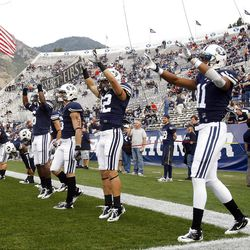 BYU players warm up as they prepare to play Utah Saturday, Sept. 17, 2011 at Lavell Edwards Stadium.