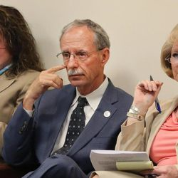 """FILE """""""" Salt Lake County Recorder Gary Ott sits with Chief Deputy Recorder Julie Dole, left, and governmental affairs liaison Karmen Sanone in the Salt Lake County Council meeting in Salt Lake City on April 26, 2016."""