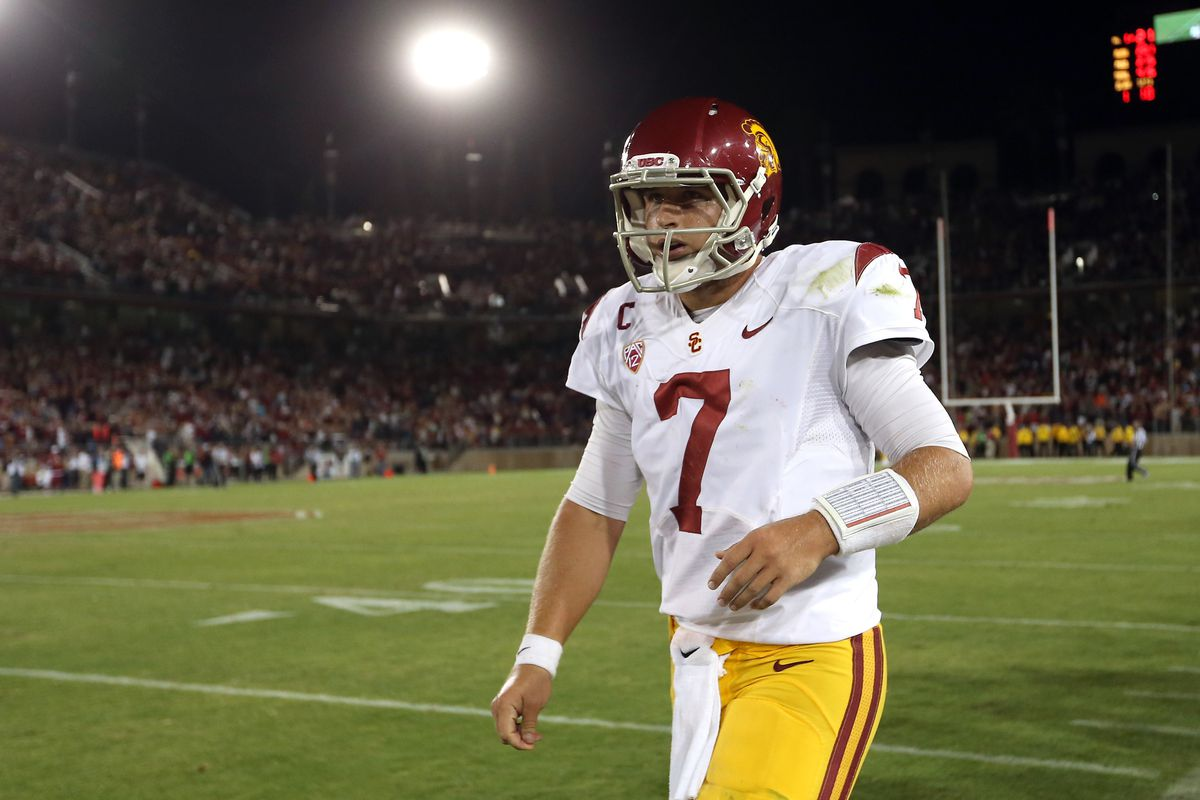 PALO ALTO, CA - SEPTEMBER 15:  Matt Barkley #7 of the USC Trojans walks off the field after they lost to the Stanford Cardinal at Stanford Stadium on September 15, 2012 in Palo Alto, California.  (Photo by Ezra Shaw/Getty Images)