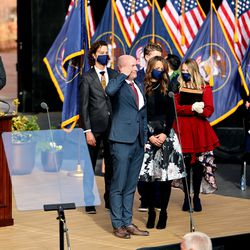 Utah Gov. Spencer Cox salutes the crowd during his inaugural ceremony at Tuacahn Center for the Arts in Ivins, Washington County, near St. George on Monday, Jan. 4, 2021.