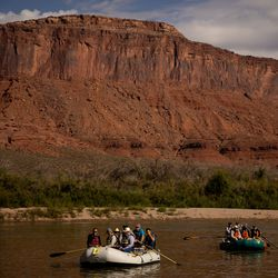 Sen. Mitt Romney, R-Utah, left, his wife, Ann, and state Sen. David Hinkins, R-Orangeville, sit in the front row of a raft as they float a section of the Colorado River northeast of Moab on Saturday, Sept. 18, 2021.