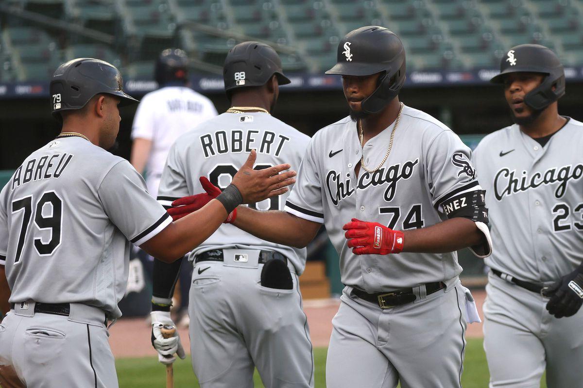 Eloy Jimenez of the White Sox celebrates his first-inning three-run home run with Jose Abreu and Edwin Encarnacion.