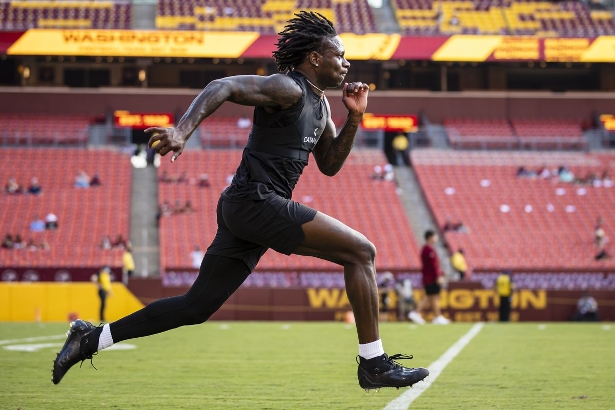 Marquise Brown #5 of the Baltimore Ravens warms up before the preseason game against the Washington Football Team at FedExField on August 28, 2021 in Landover, Maryland.