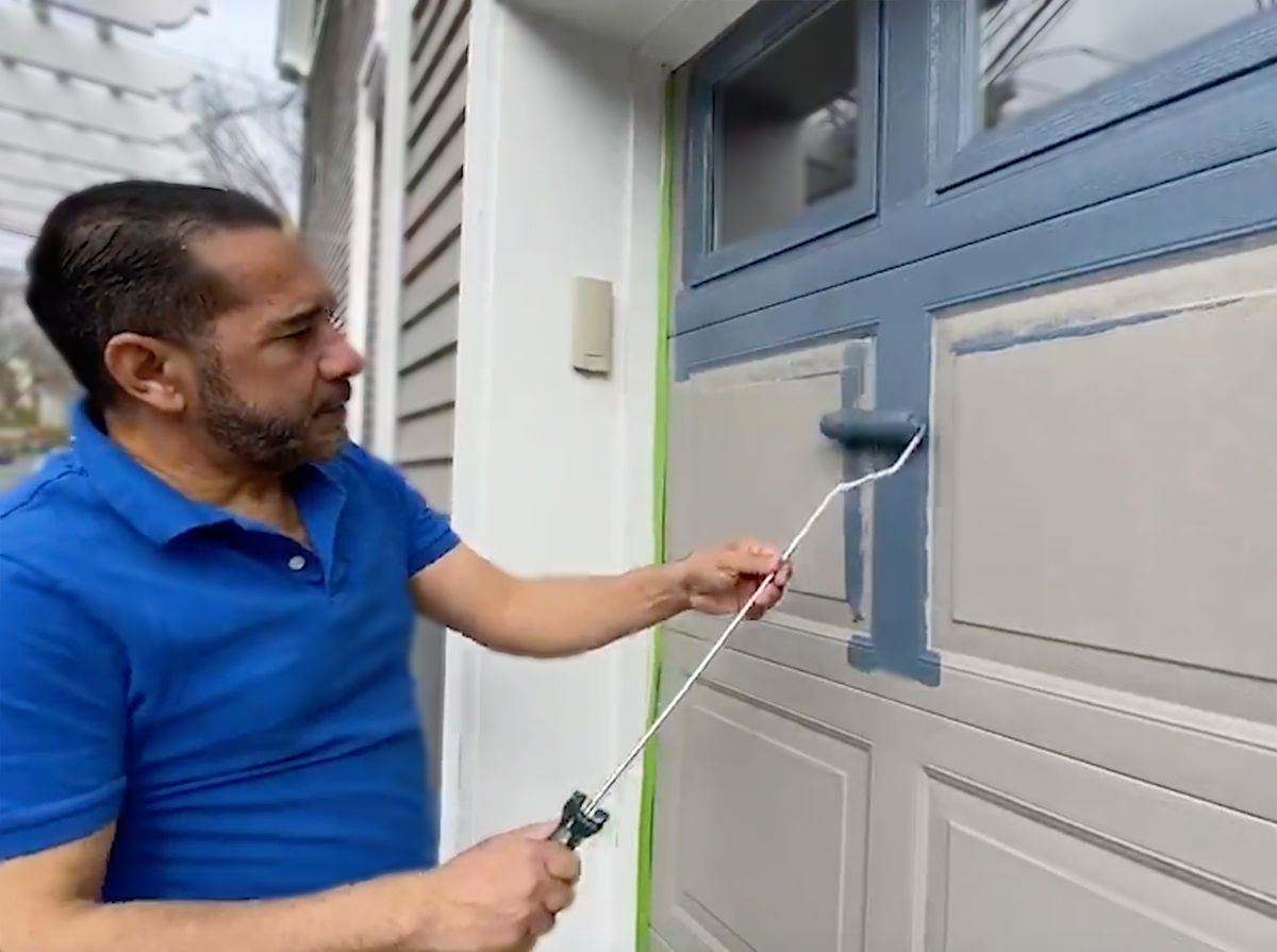 Spring 2021, Reno Planner: Garage Door Smarts, Mauro Henrique paints a garage door