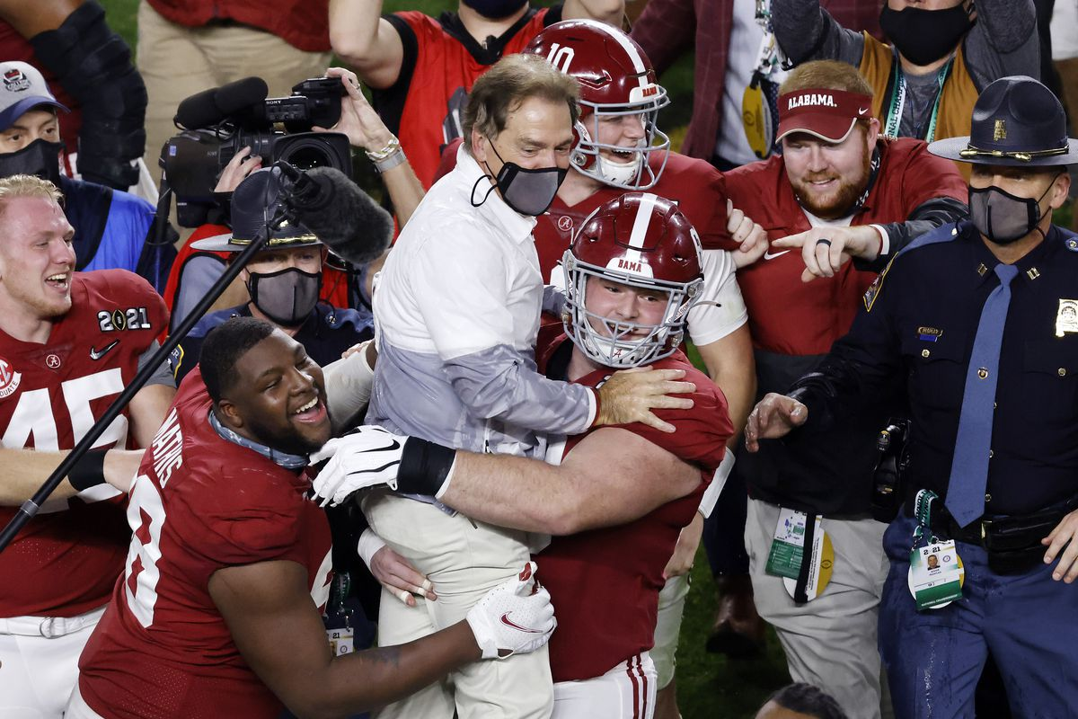 Alabama coach Nick Saban gets a ride from his players after the Crimson Tide beat Ohio State for the national championship Monday night.