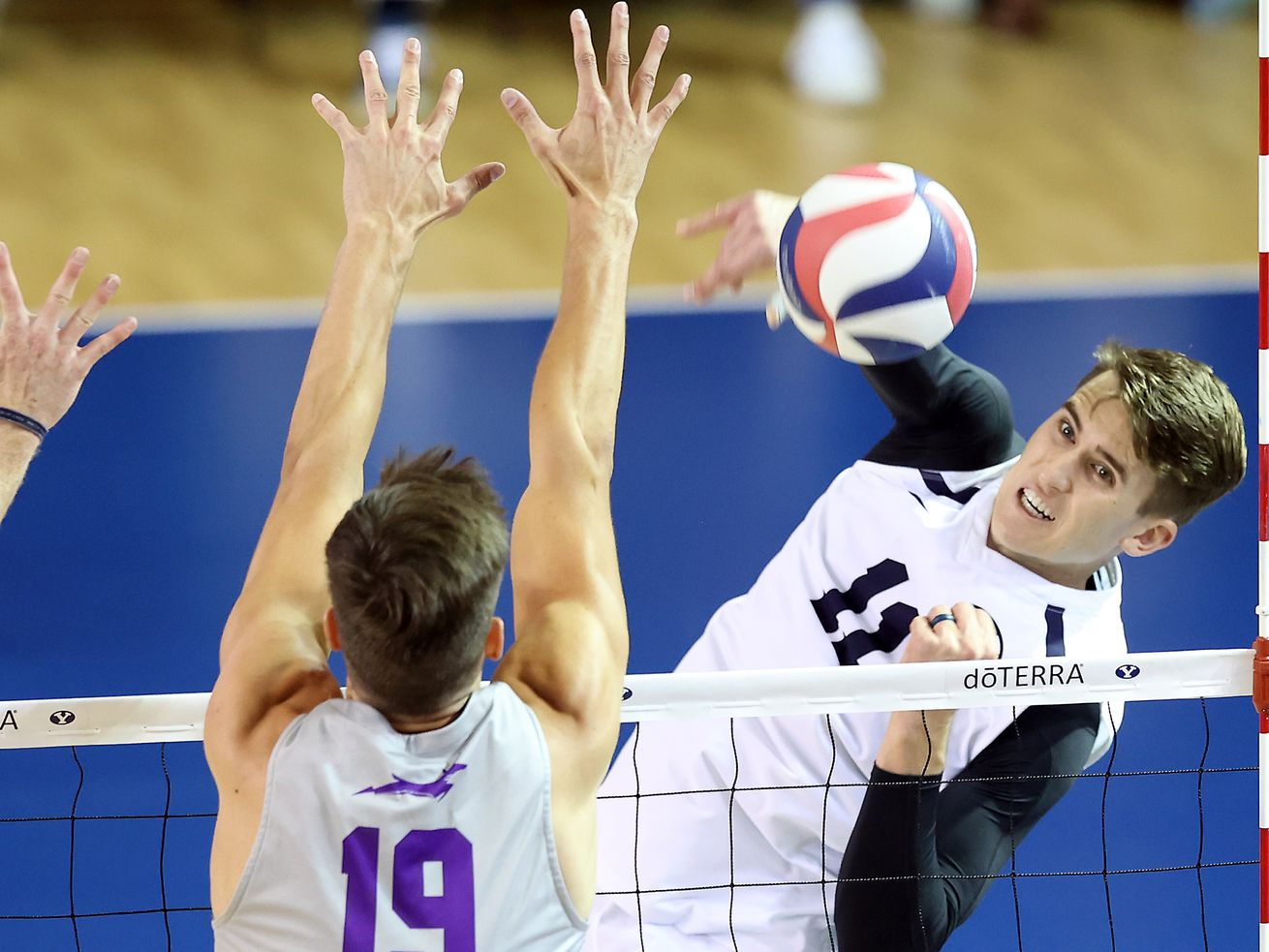 BYU's Zach Eschenberg hits the ball past Grand Canyon's Hugo Fischer as they play in the semifinals of the Mountain Pacific Sports Federation Championship at the Smith Field House in Provo on Friday, April 23, 2021.