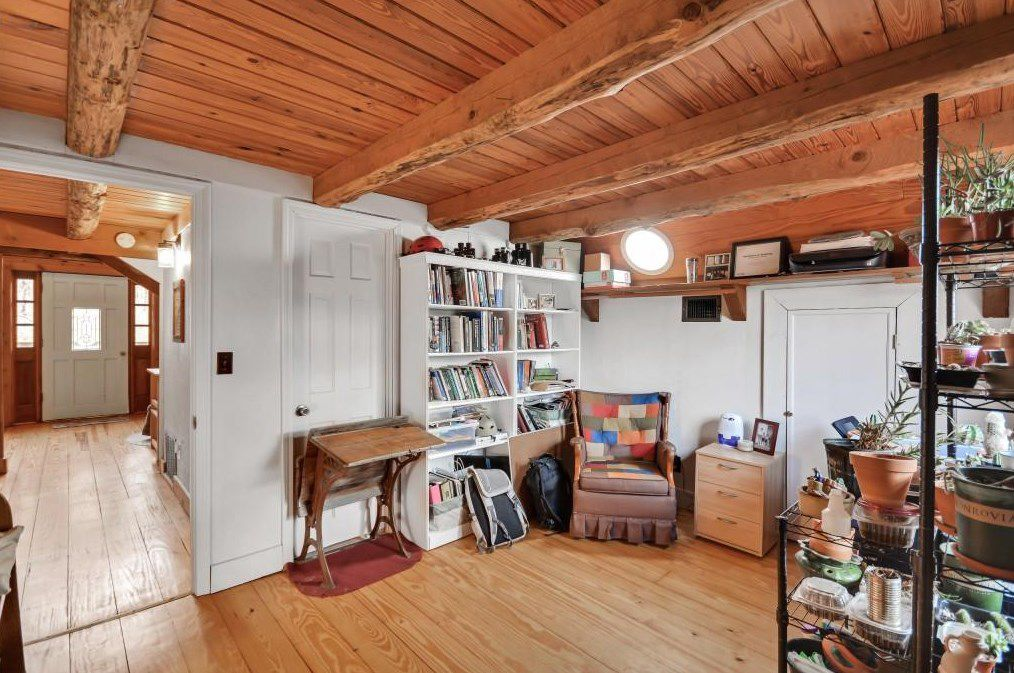 A library room with exposed wood beams overhead.