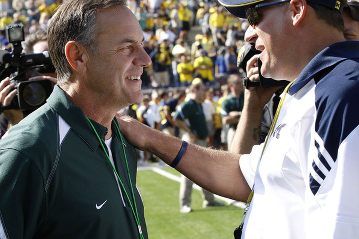 ANN ARBOR, MI - OCTOBER 09: Michigan State head coach Mark Dantonio and Michigan head coach Rich Rodriguez meet prior to the start of the game October 9, 2010 at Michigan Stadium in Ann Arbor, Michigan. (Photo by Leon Halip/Getty Images)