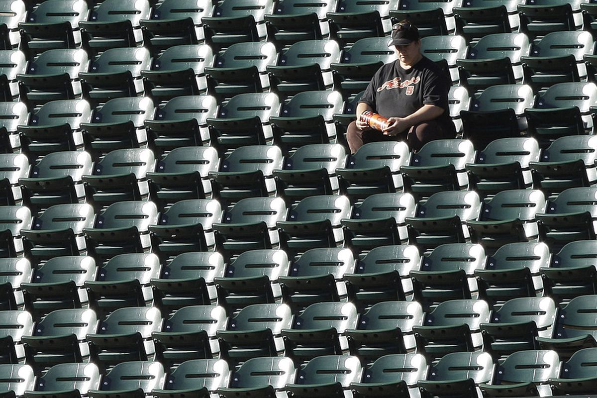 HOUSTON - MAY 14:  A fan basks in the sunlight at Minute Maid Park on May 14, 2011 in Houston, Texas.  (Photo by Bob Levey/Getty Images)