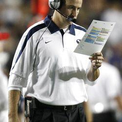 BYU's Offensive Coordinator Brandon Doman checks his play sheet as BYU and Utah play Saturday, Sept. 17, 2011