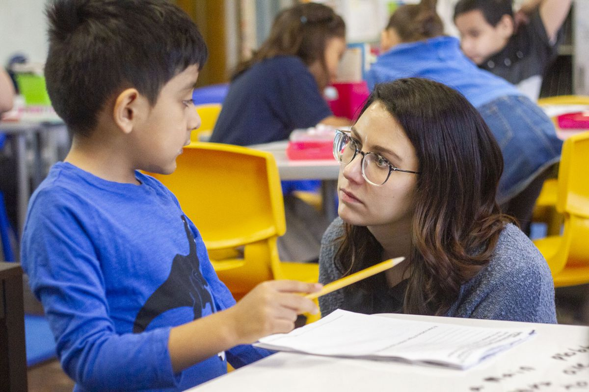 Teacher Sarah Schielke attends to a question from Nathan V. at CICS West Belden. The Chicago charter school employs the personalized learning method for its K-8 students. The school is part of the Chicago International Charter School network, and is managed by Distinctive Schools,. Photo by Stacey Rupolo/Chalkbeat NOTE: Last names not given by school
