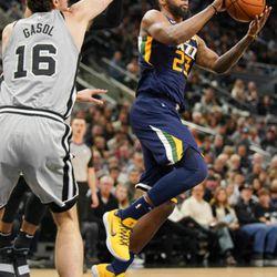 Utah Jazz's Royce O'Neale (23) looks to pass as he is guarded by San Antonio Spurs' Pau Gasol during the second half of an NBA basketball game Saturday, Feb. 3, 2018, in San Antonio. Utah won 120-111. (AP Photo/Darren Abate)