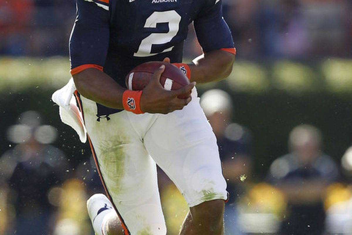 AUBURN - OCTOBER 16:  Quarterback Cam Newton #2 of the Auburn Tigers runs with the ball during the game against the Arkansas Razorbacks at Jordan-Hare Stadium on October 16 2010 in Auburn Alabama.  (Photo by Mike Zarrilli/Getty Images)