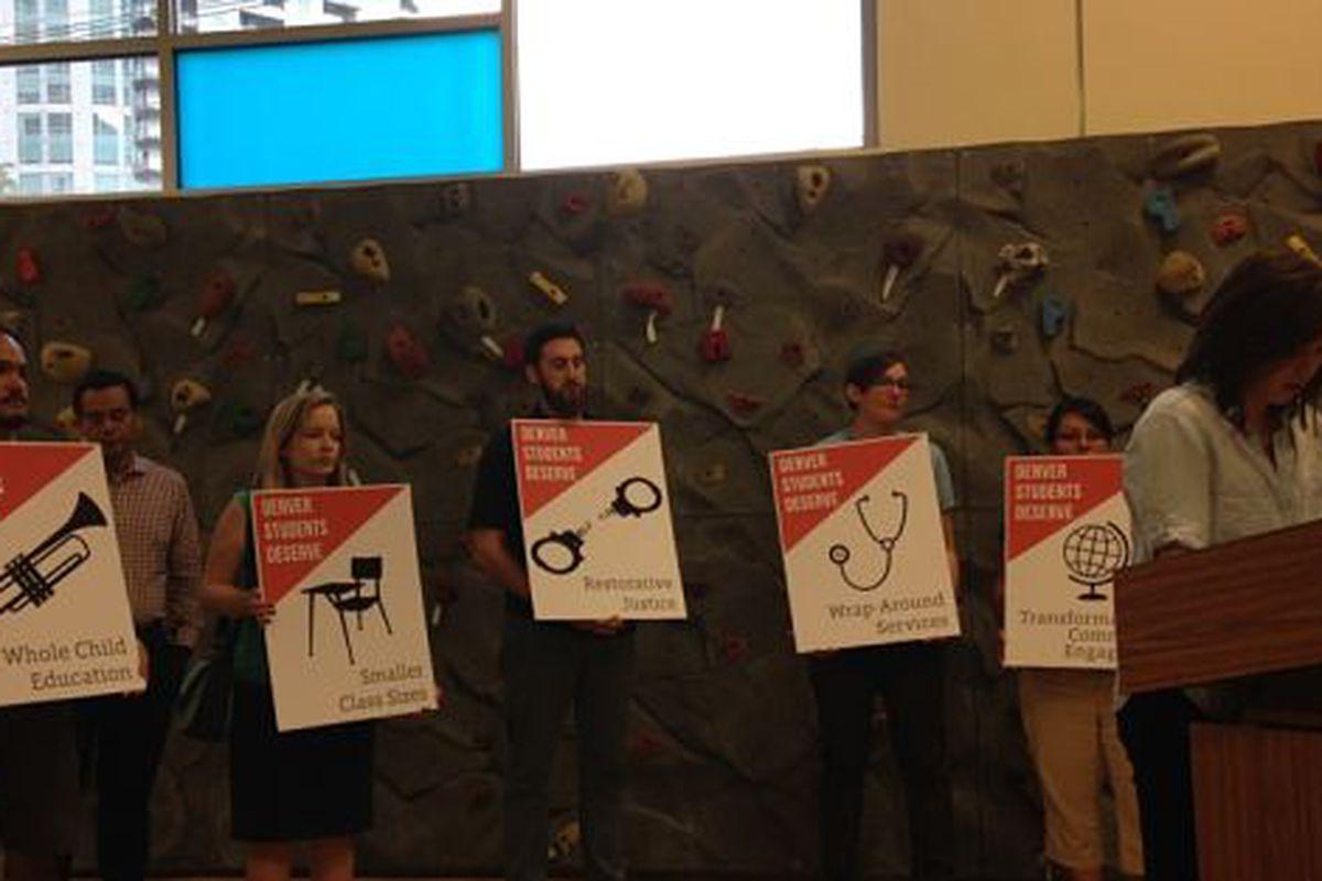 Denver teachers present their demands to the school board.
