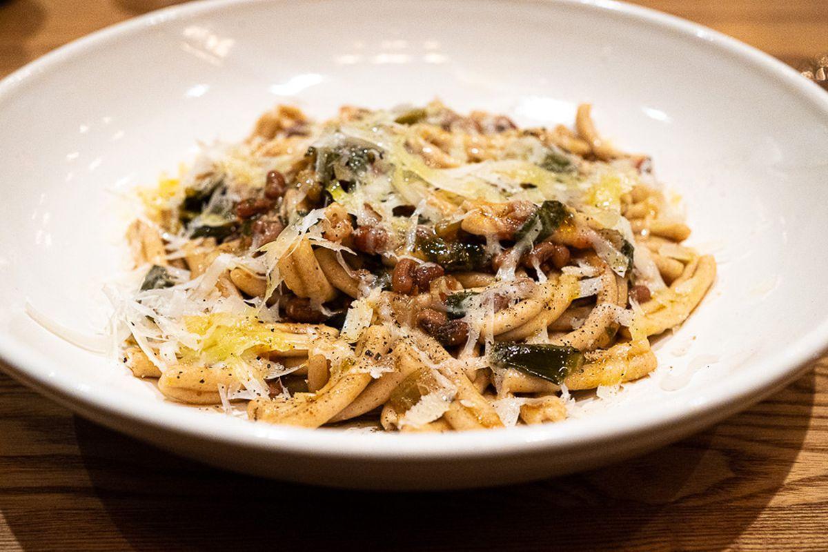 Cassarecce pasta with sea island red peas, collard greens, and pecorino Romano cheese from Reveler's Hour