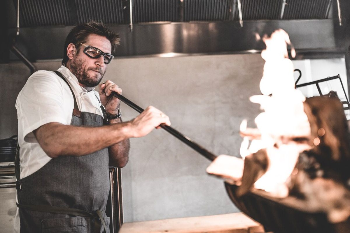 Chef Curtis Stone grills meat at his LA restaurant, Gwen.