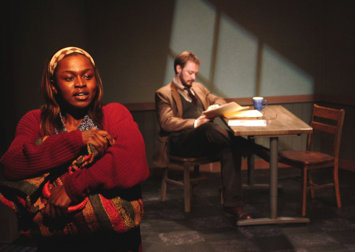 """Yetide Badaki (left) as Juliette, a young survivor of the 1994 anti-Tutsi genocide in Rwanda, in Victory Gardens Theater's """"I Have Before Me a Remarkable Document Given to Me by a Young Lady from Rwanda."""""""