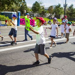 Ian Colton dances along behind the Salt Lake Winder West Stake float during the Days of '47 Union Pacific Railroad Youth Parade held Saturday, July 18, 2015, in Salt Lake City.