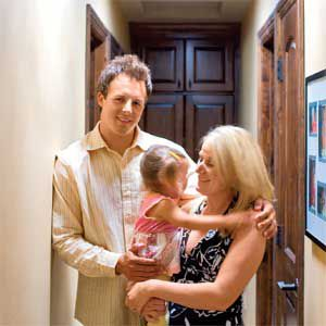<p>Justin and Kristin Gonzalez, shown with daughter Riley, pipe in daylight with tubular skylights to reduce their electricity bill.</p>