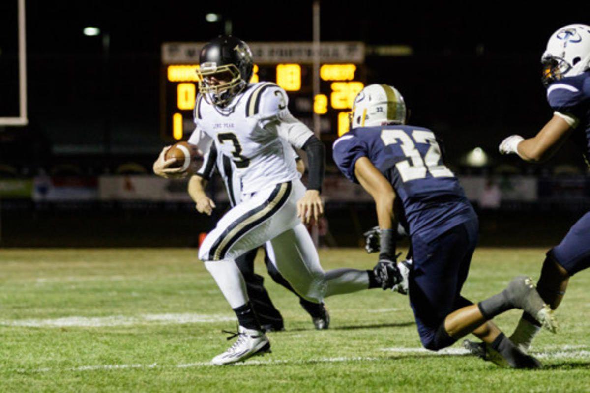 Lone Peak's Talmage Gunther (3) with the quarterback keep.