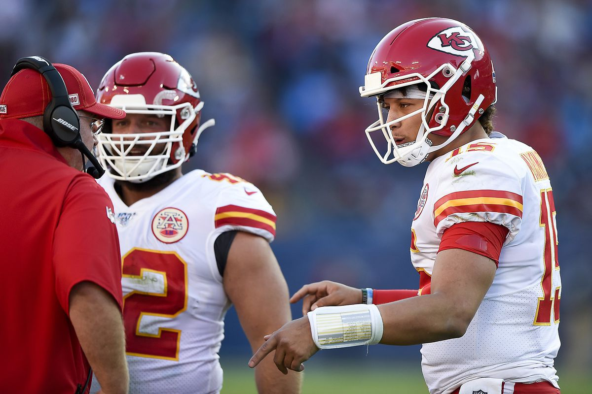Kansas City Chiefs coach Andy Reid talks to quarterback Patrick Mahomes during action against the Tennessee Titans on November 10, 2019, at Nissan Stadium in Nashville, Tenn.