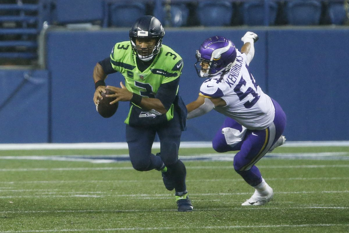 Seattle Seahawks quarterback Russell Wilson (3) escapes from Minnesota Vikings middle linebacker Eric Kendricks (54) during the fourth quarter at CenturyLink Field.