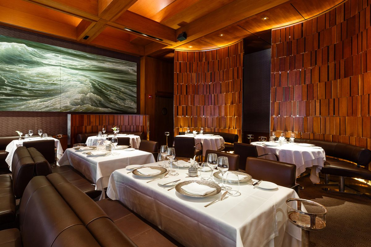 Deep Water No. 1 by Ran Ortner, a painting of a tempestuous and sunlit Pacific Ocean, overlooks the leather-banquette clad dining rom at Le Bernardin