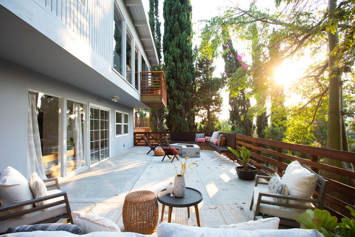 A large backyard with wooden fence and built-in seats.