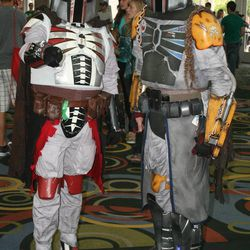 """Kandosii (left) and Kibiri Foxx (right) from Seattle dressed as """"Star Wars"""" bounty hunters for the inaugural Salt Lake Comic Con."""