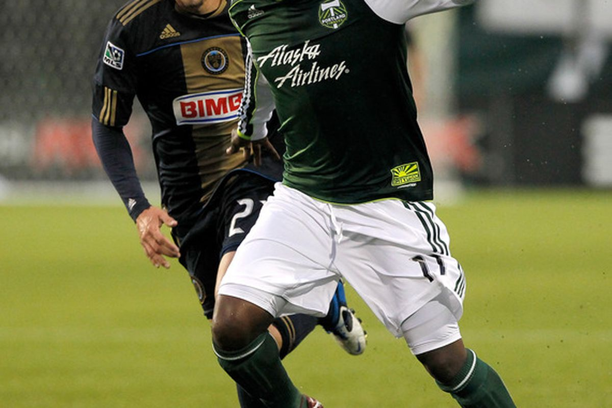 PORTLAND, OR - MAY 06:  Kalif Alhassan #11 of the Portland Timbers dribbles the ball against Michael Farfan #21of the Philadelphia Union  on May 6, 2011 at Jeld-Wen Field in Portland, Oregon.  (Photo by Jonathan Ferrey/Getty Images)