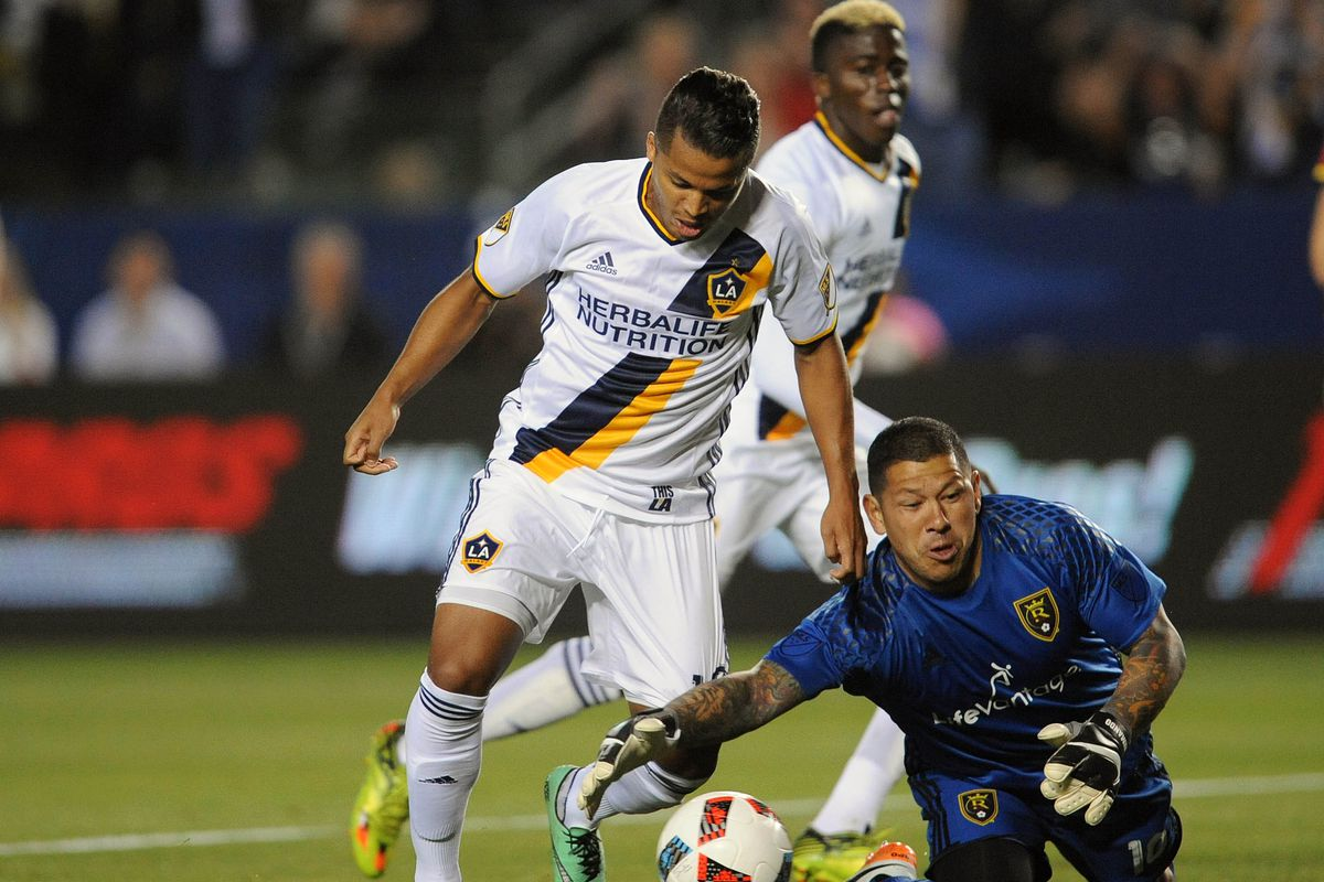 Nick Rimando makes a save versus Giovani dos Santos in Real Salt Lake's 5-2 loss on Saturday