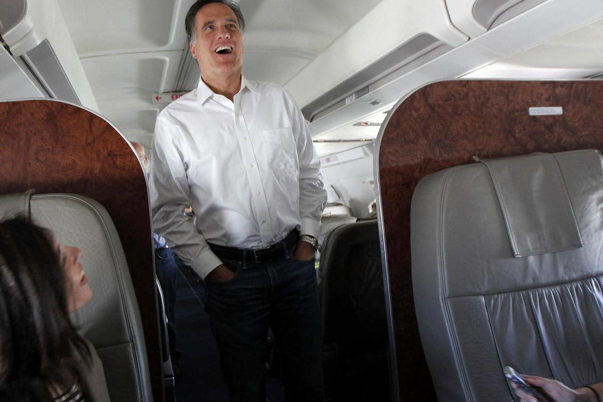 In this Feb. 1, 2012, file photo Republican presidential candidate, former Massachusetts Gov. Mitt Romney talks to reporters on his campaign plane en route from Tampa, Fla. to Minnesota and Nevada.