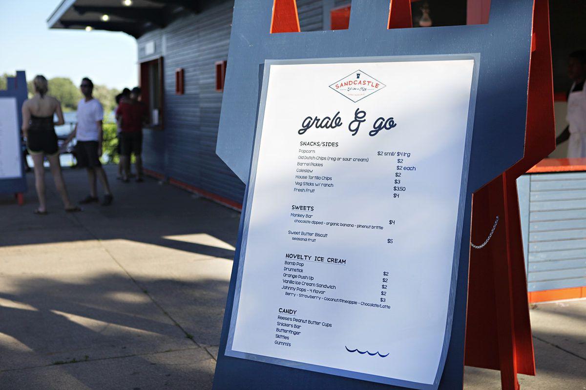 The grab and go menu board outside Sandcastle