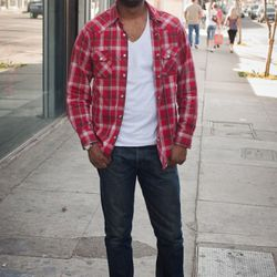"""<a href=""""http://la.racked.com/archives/2011/03/07/stu_at_poinsettia_and_melrose.php"""" rel=""""nofollow"""">Stu</a>'s shirt is from Ralph Lauren, his jeans are Levi's, his shoes are Clarks, and the sunglasses are vintage Giorgio Armani. <br /><br />Photo by <a hr"""