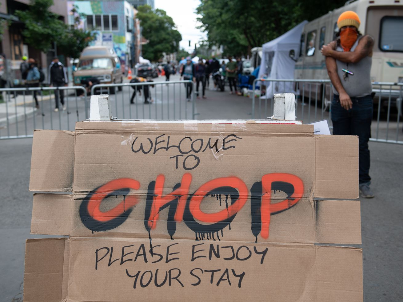 "Cardboard with the word ""CHOP"" written on it. The cardboard is in the street of the Seattle Autonomous Zone, a police-free area also known as CHOP or CHAZ."