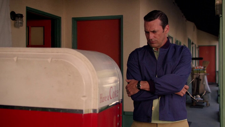 Don tries to fix a Coke machine on Mad Men.
