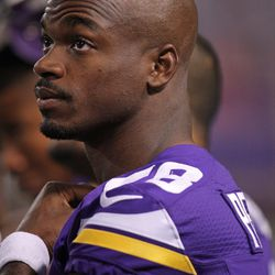 Aug 9, 2013; Minneapolis, MN, USA; Minnesota Vikings running back Adrian Peterson (28) looks on during the second quarter against the Houston Texans at the Metrodome.