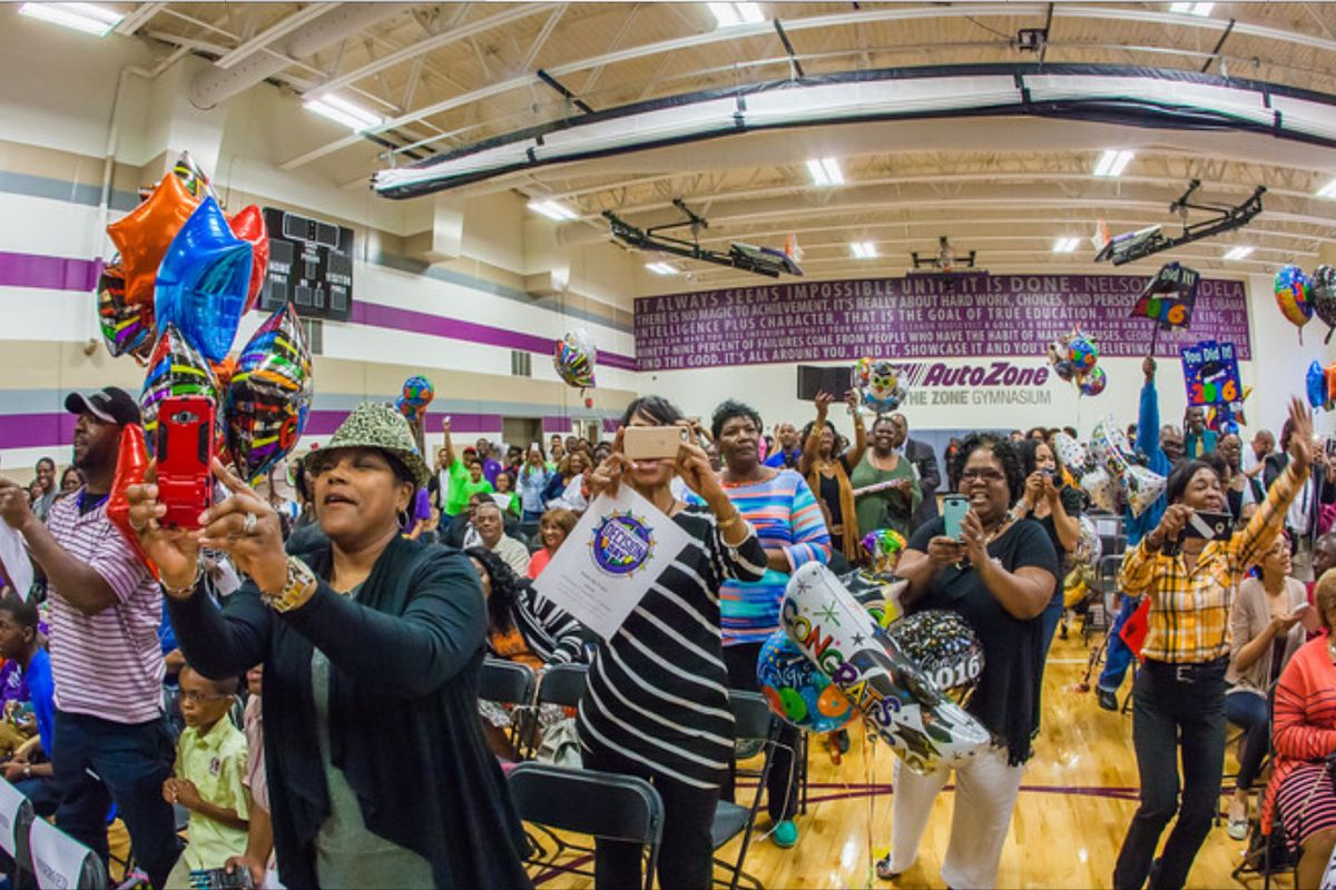 """Family members celebrate """"Decision Day"""" at Soulsville Charter School last May when graduating seniors announced their postsecondary pathway."""