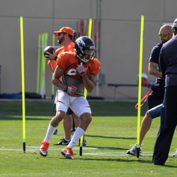 Broncos rookie WR Mark Chapman works through the course during receiver drills.