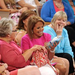 """This Aug. 8, 2012 photo released by Disney-ABC Domestic Television shows host Katie Couric sitting with audience members during a taping of her new talk show """"Katie."""" Couric's new show will debut on Monday, Sept. 10."""