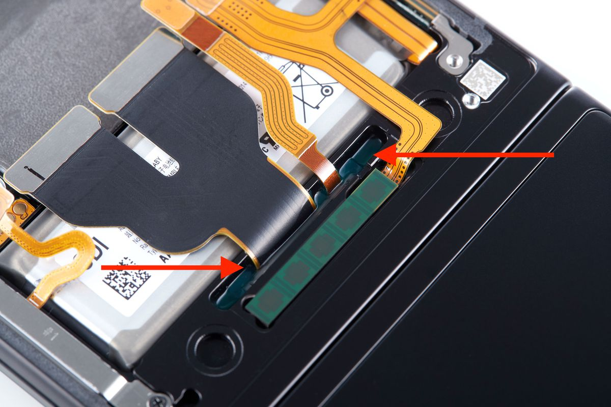 A cured-in-place gasket for water sealing on a Galaxy Z Flip 3. It's injected in liquid form at the factory and then cures to create a flexible seal around the cable ribbon.