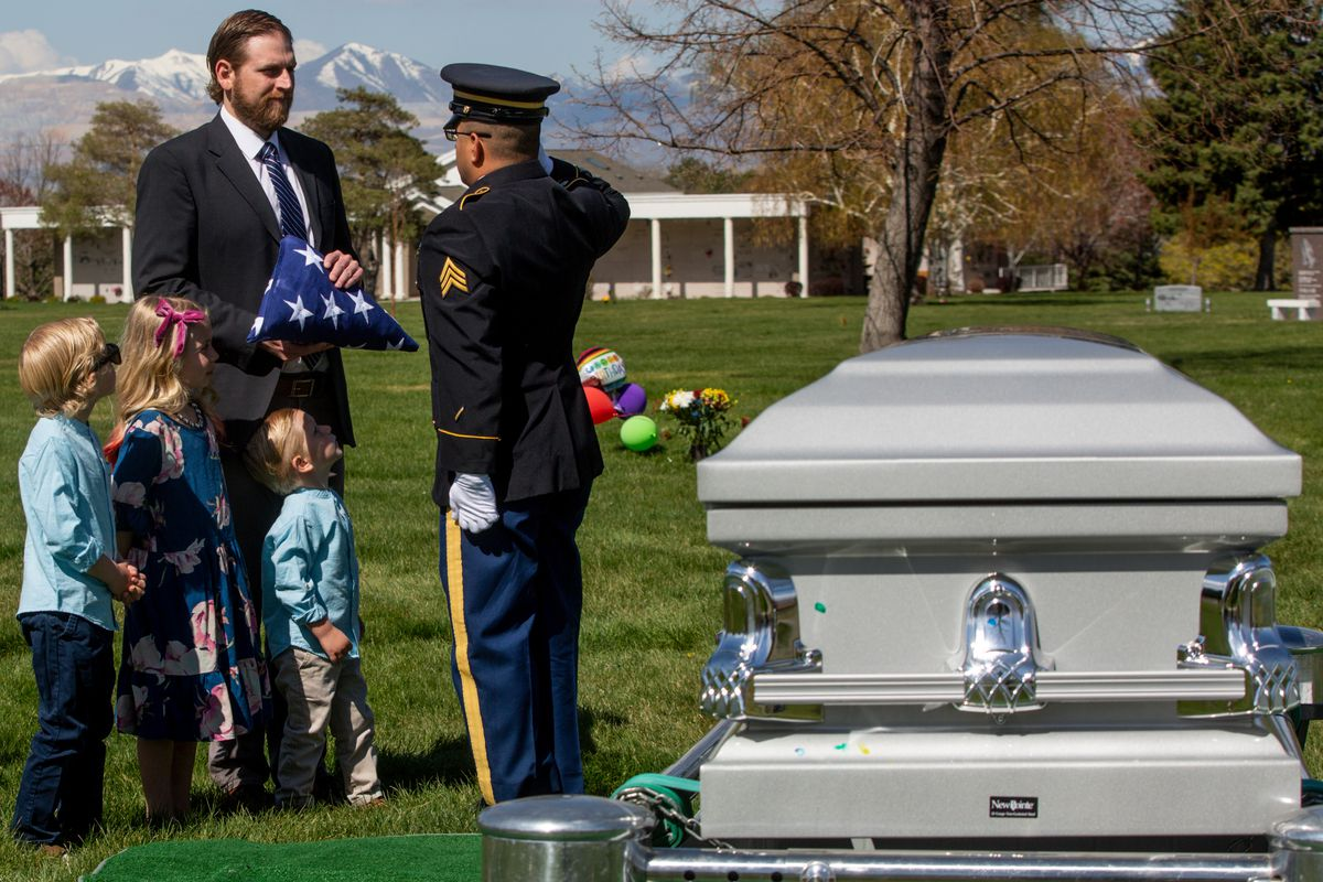 Joel Ragar receives an American flag during his grandfather Richard Ragar's funeral service as his children Decklin Ragar, 5, Evalee Ragar, 7, and Wynston Ragar, 3, watch the ceremony at Larkin Sunset Gardens in Sandy on Monday, April 20, 2020. The World War II veteran lived in Alpine with his wife before moving to Arizona and passing away after being hospitalized alone for about a month at age 93 during the coronavirus pandemic.