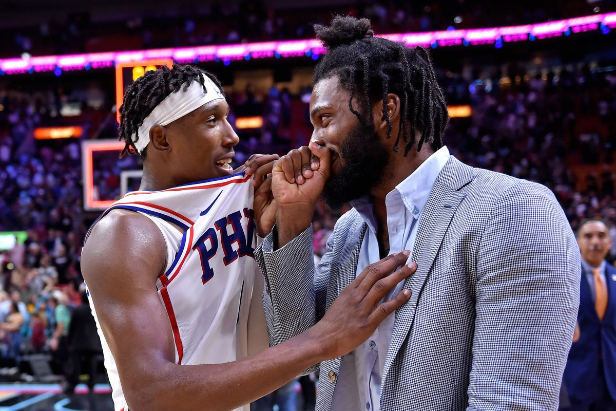Philadelphia 76ers guard Josh Richardson talks with Miami Heat forward Justise Winslow after their game at American Airlines Arena. The Heat won in overtime.