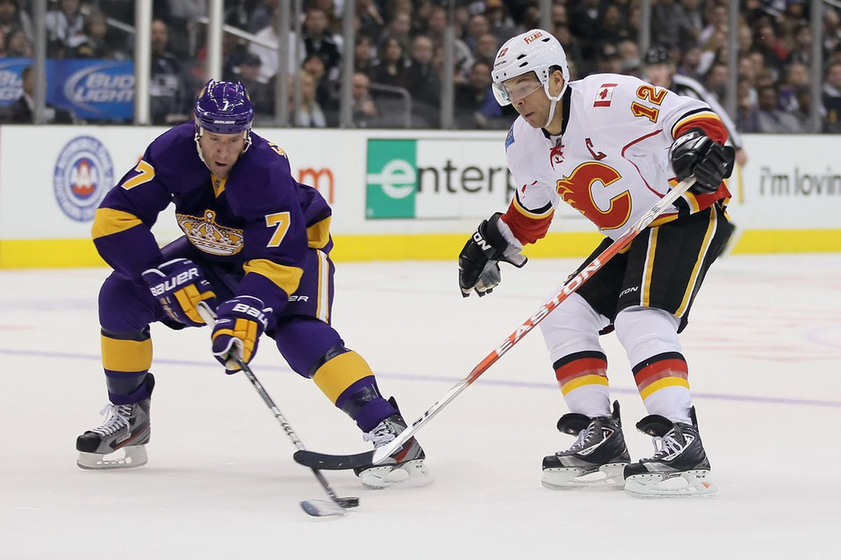 Rob Scuderi (7) is one of several college hockey alums to move to a new NHL team since free agency began July 5, 2013.